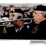 Ken Truswell & Mick Bridge blowing The Last Post at the war Memorial in front of the Town Hall 2009.