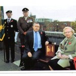 Paul Holmes & Hazel Greaves at a Dedication of bench to Fred Greaves VC outside the War memorial.